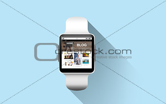 close up of smart watch with blog page on screen