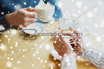 close up of couple drinking tea at cafe