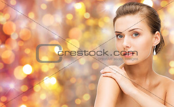 beautiful woman with diamond ring and earrings