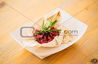 close up of dough cornet with beetroot filling