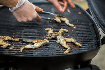 close up of frog meat grill at street market