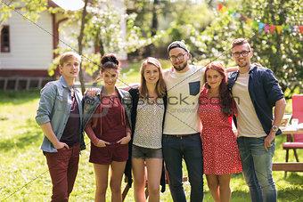 happy teenage friends hugging at summer garden