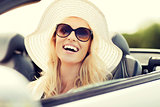 happy woman driving in cabriolet car