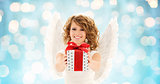 happy woman with angel wings and christmas gift