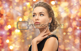 beautiful woman with gem stone earrings