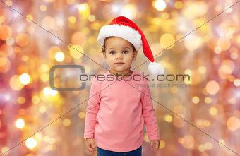 beautiful little baby girl in christmas santa hat