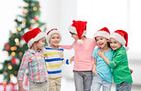 happy little children in christmas santa hats
