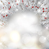 Silver Christmas tree branches and berries on bokeh lights backg