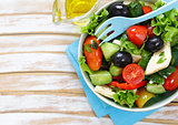 Mediterranean salad with olives, cheese and vegetables. Healthy food.