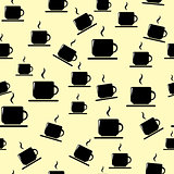 Tea or coffee cups on yellow background.
