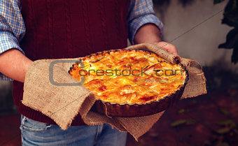 Apple pie in the man's hands