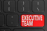 Executive Team on black keyboard