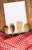 Kitchen Utensils on Wooden Table with Notebook