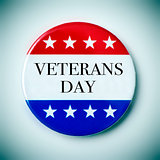 text veterans day in a badge