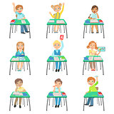 Children Sitting At School Desks In Class