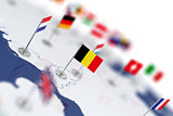 Belgium flag in the focus. Europe map with countries flags