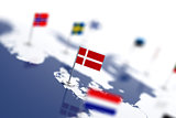Denmark flag in the focus. Europe map with countries flags