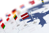 Latvia flag in the focus. Europe map with countries flags