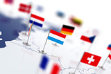 Luxembourg flag in the focus. Europe map with countries flags