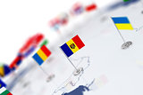 Moldova flag in the focus. Europe map with countries flags
