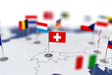 Swiss flag in the focus. Europe map with countries flags