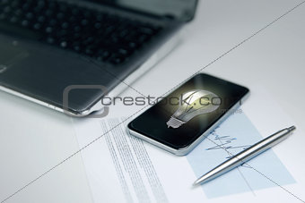 close up of smartphone with lightbulb on screen
