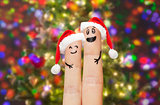 close up of two fingers with smiley and santa hats