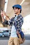 hipster man taking selfie on smartphone
