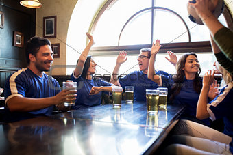 football fans with beer celebrating victory at bar