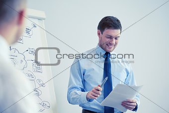 group of smiling businessmen meeting in office