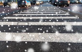 close up of pedestrian crosswalk on city parking