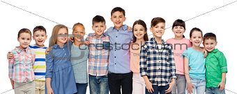 group of happy smiling children hugging over white