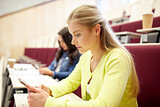student girls with smartphones on lecture