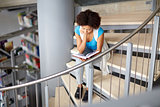 african student girl reading book at library