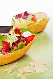 Taco shell filled with salad.