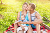 Happy family enjoying a picnic outdoors