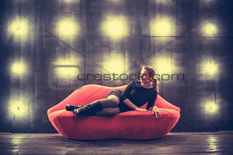 Beautiful luxury fashionable sexy woman on red lips sofa  the lights backgound