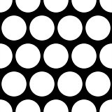 Seamless vector dark pattern with big white polka dots on black background