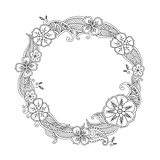 Floral hand drawn round frame in zentangle style isolated on white.