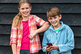 Boy and Girl Smiling Children Using Cell Phone