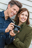 Happy Middle Aged Man and Woman Couple Using Camera