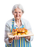 Senior woman holding fresh buns