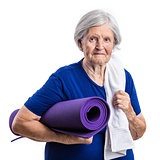 Senior woman holding yoga mat