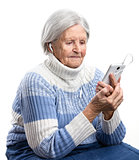 Senior woman listening to music or watching video on smartphone