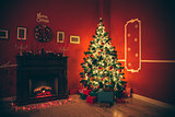 Beautiful new year room with decorated Christmas tree, gifts and fireplace with the glowing lights at night. The idea for postcards. Soft focus. Shallow DOF