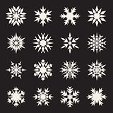 Set of Sixteen Symmetrical White Snowflakes Design on Black Background