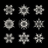 Set of Nine Vector White Semi Transparent Snowflake  Shape Design Elements on Black Background