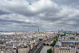 Eiffel tower over Paris, cloudy day
