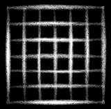 sprayed grid grunge graffiti in white over black