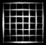 sprayed grid grunge graffiti in white over black